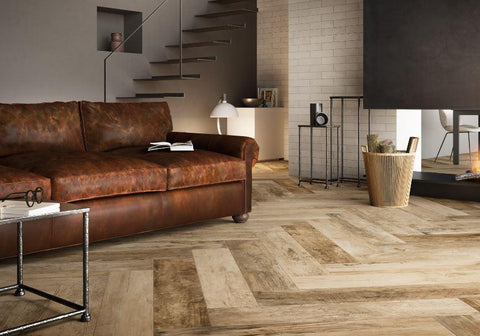 almond patterned tfloor tile with leather couch and floating stairs