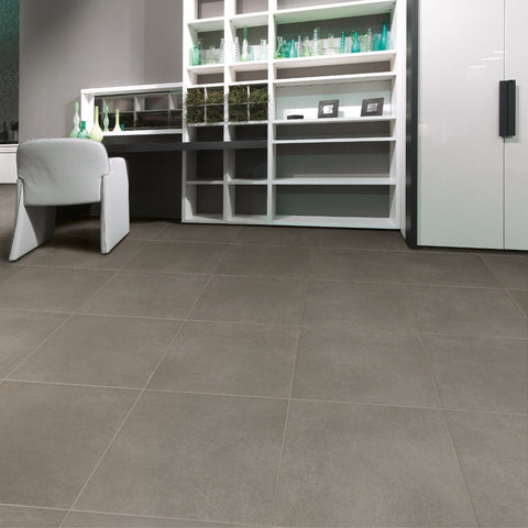 Velvet grey tile 24x24 on floor with white bookshelves and desk
