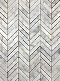 Honed/polished, monochromatic marble tile pieces in chevron mosaic