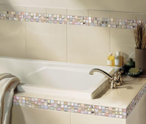 Gloss almond ceramic trim tile around tub with city lights glass mosaic