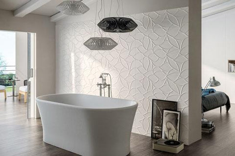 white textured and patterned tile on wall with freestanding bathtub
