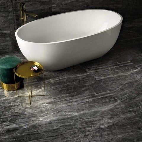 Cosmic black tile in a bathroom surrounding a stand-alone white tub.