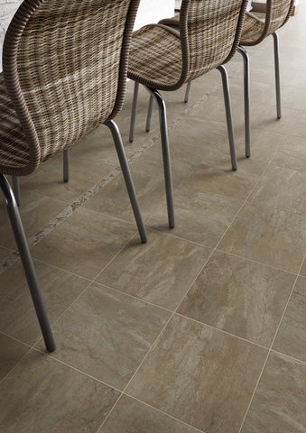 Rye porcelain tile 12x12 on floor under wicker chairs
