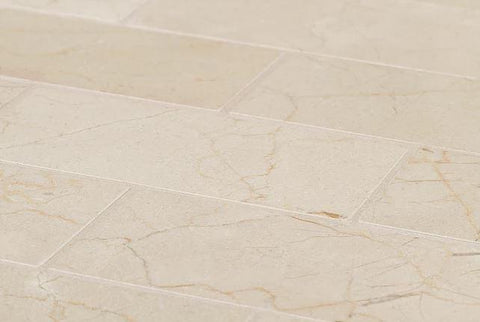 Honed marble tile in brick mosaic and natural tones as flooring