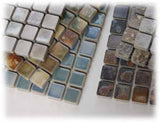 Loose Garan mosaic sheets on a surface.