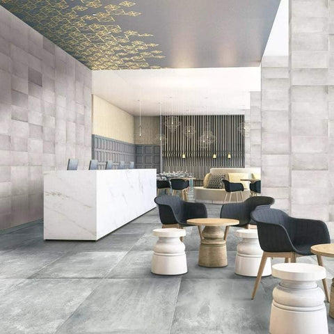 Icon porcelain tile on the floors and walls of a modern commercial lobby