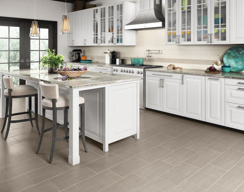 Grey Koncrete tiles on the floor in rectangle offset pattern with white and decorative Koncrete tiles on the backsplash of the kitchen.