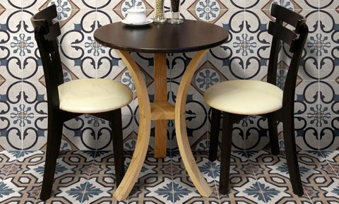 Soho, Nottinghill porcelain field tiles on the wall and floor around a table and chairs.