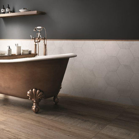 almond tile  natural wood look floor with gold clawfoot bathtub