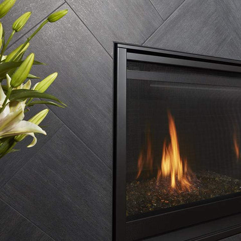 Metalwood tile in the color Carbonio set herringbone around a fireplace insert