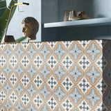 Reverie 10 porcelain pattern tile on a backsplash shelf with items on top