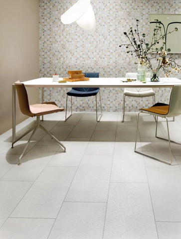 Ivory tiles on the floor, Soprano mosaic tiles on the wall with table and four chairs
