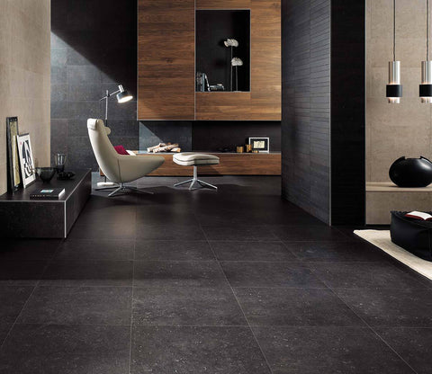 black tile as floor in living room with natural wood elements