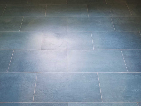 Installation of 12x24 formula blue theoretical bold tile on a floor