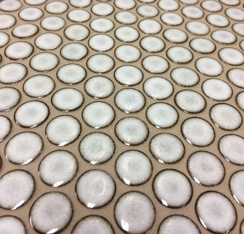 Volcanic Ash 2625 porcelain penny round close up installed and grouted.