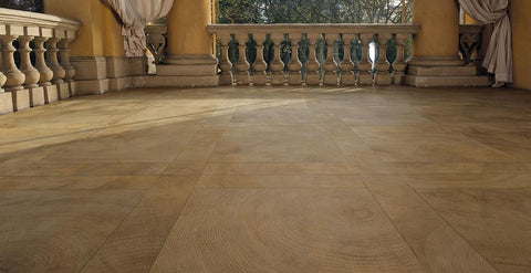 Beige Heartwood porcelain cross cut wood plank tile in both field sizes on the floor of a villa with curtains.