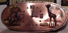 Wall clock mounted within hand painted Copper plate