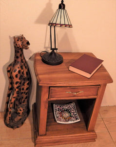 Cheetah wood sculpture at Roots Cabinets & Tile