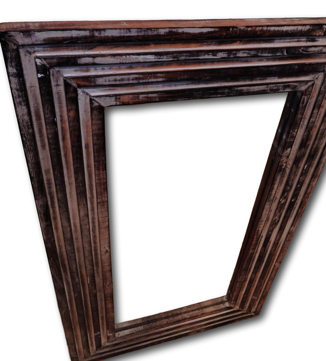 Wall mirror in frame hand carved from Reclaimed wood