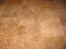 Natural stone travertine and slate tile at Roots Hardwood Furniture