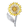 18K WHITE GOLD SUNFLOWER BROOCH WITH DIAMONDS AND SAPPHIRES