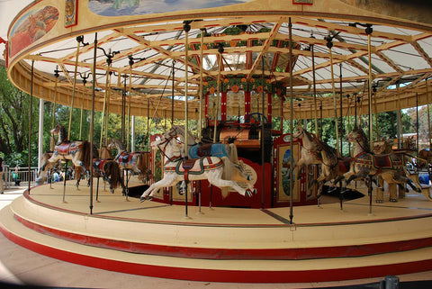 Empty and stopped merry-go-round symbolizing impact of pandemic on global commerce