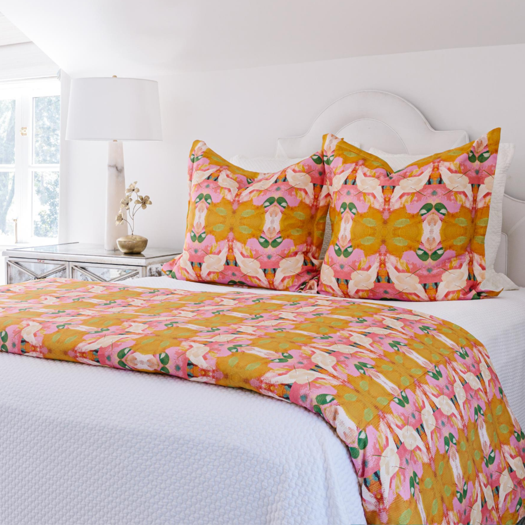 Flower Child Marigold duvet cover in vivid oranges and pinks from Laura Park Designs