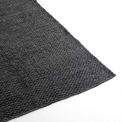Alvia heathered charcol outdoor rug Four Hands rug and edge detail
