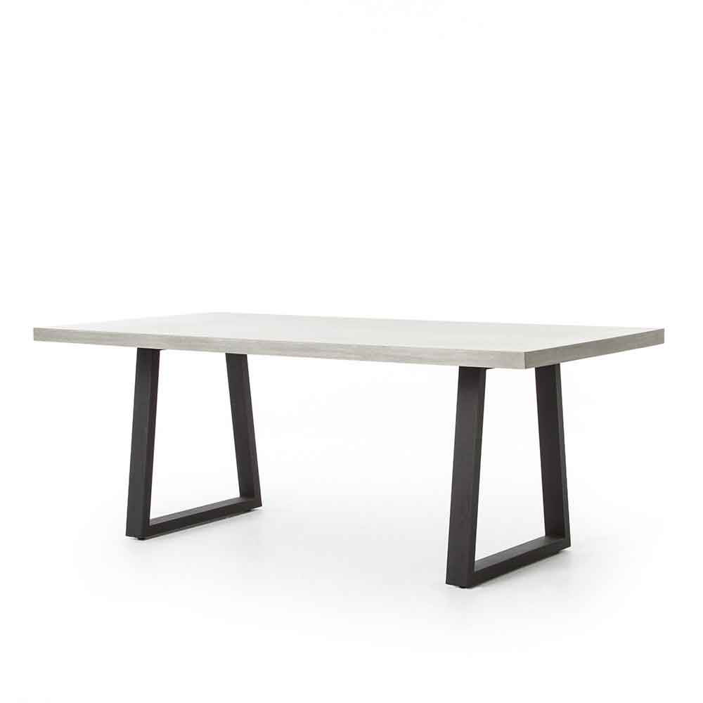 Outdoor and indoor poly-resin dining table from Four Hands