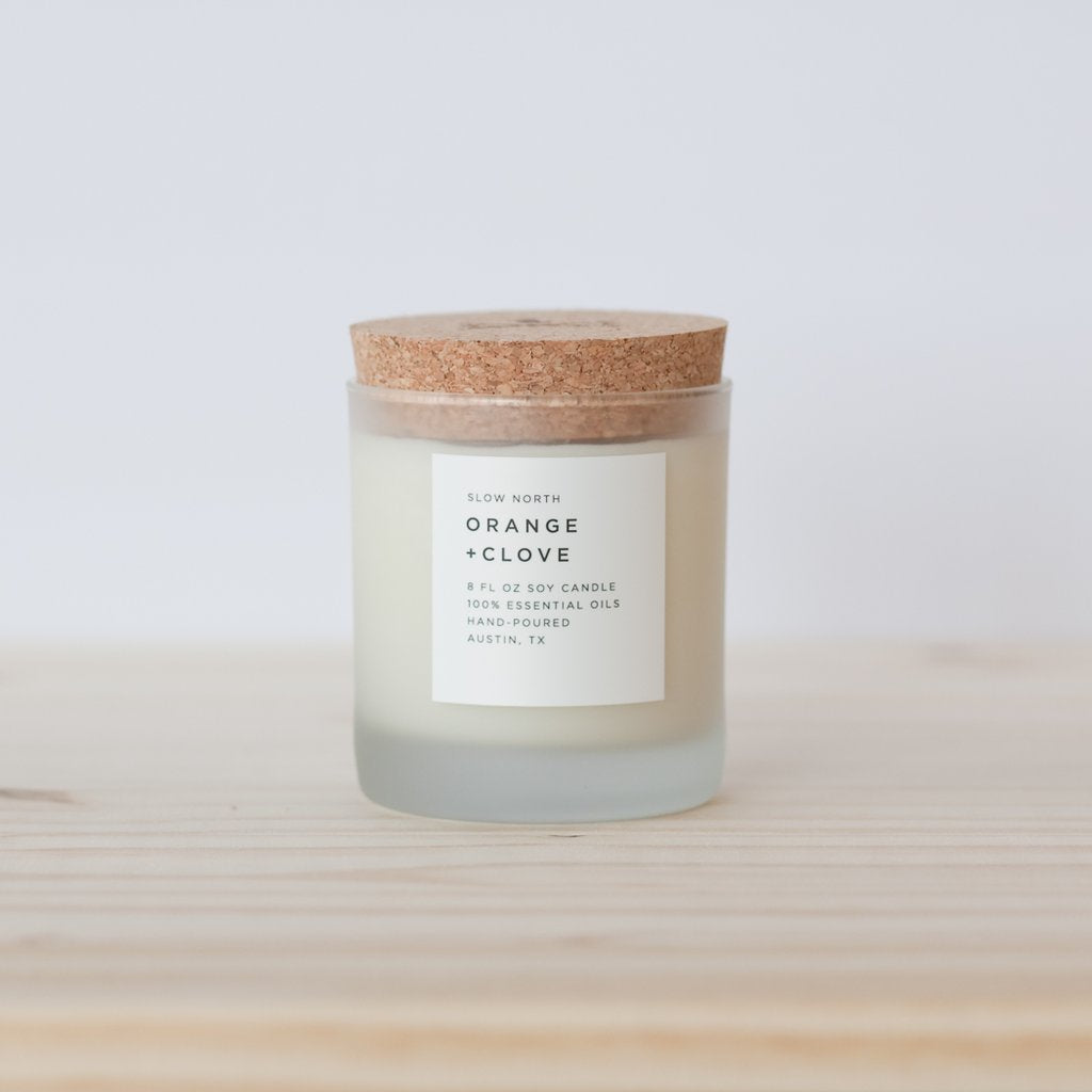 Slow North 100% Orange and Clove essential oil wax candle in frosted glass