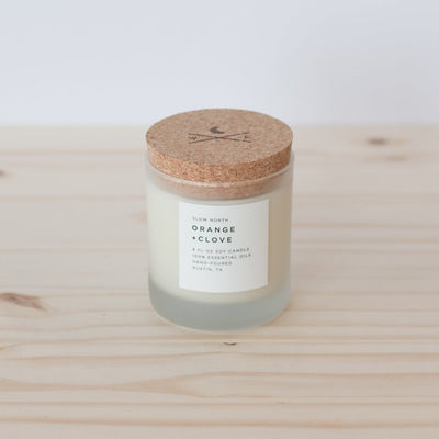 Slow North 100% Orange and Clove essential oil wax candle with branded cork lid