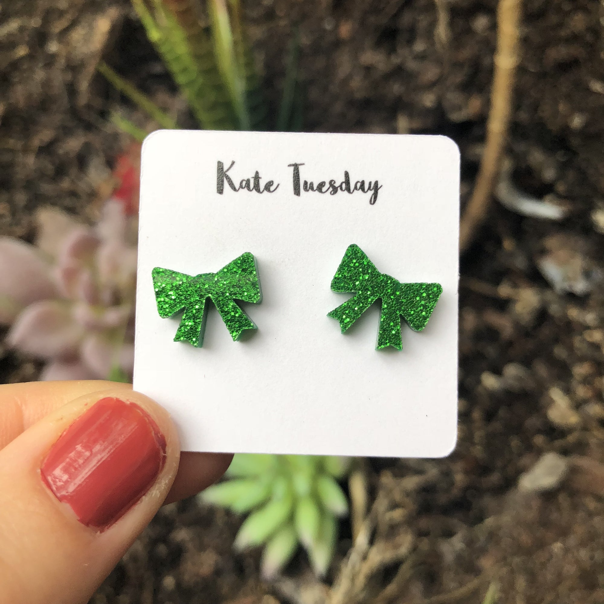 Green bow acrylic earrings from Kate Tuesday