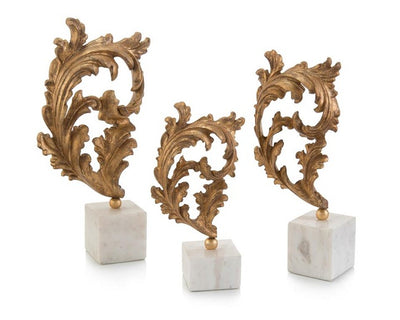 Gold baroque leaf scultures on marble from John Richard Collection