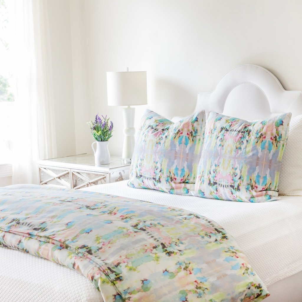 Lemonade Stand duvet cover in a variety of soft blues, greens, and yellows from Laura Park Designs