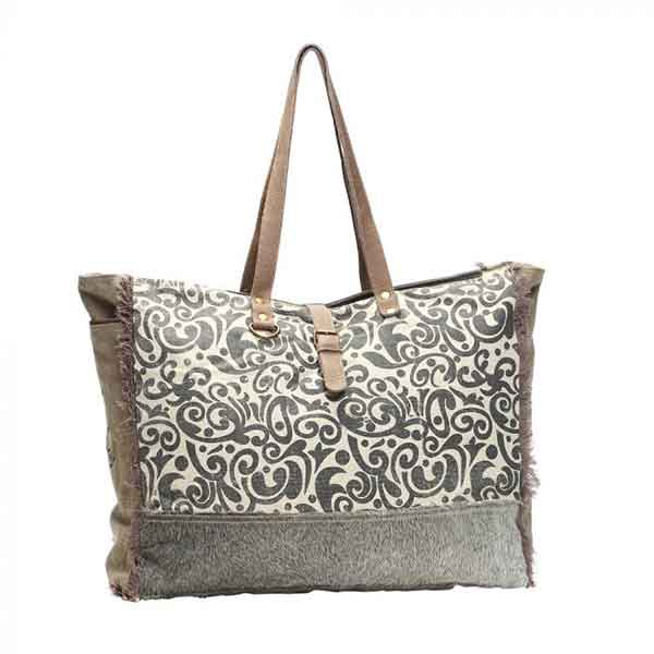 Floral print weekender bag of canvas, leather and hairon from Myra Bag