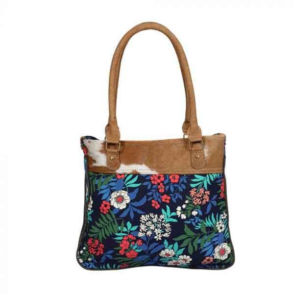 Beatific small bag with colorful floral pattern and hairon hide band from Myra Bag front view