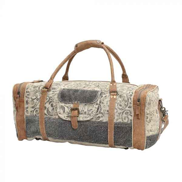 Floral print & hairon traveler bag with zippered compartments from Myra Bag front view