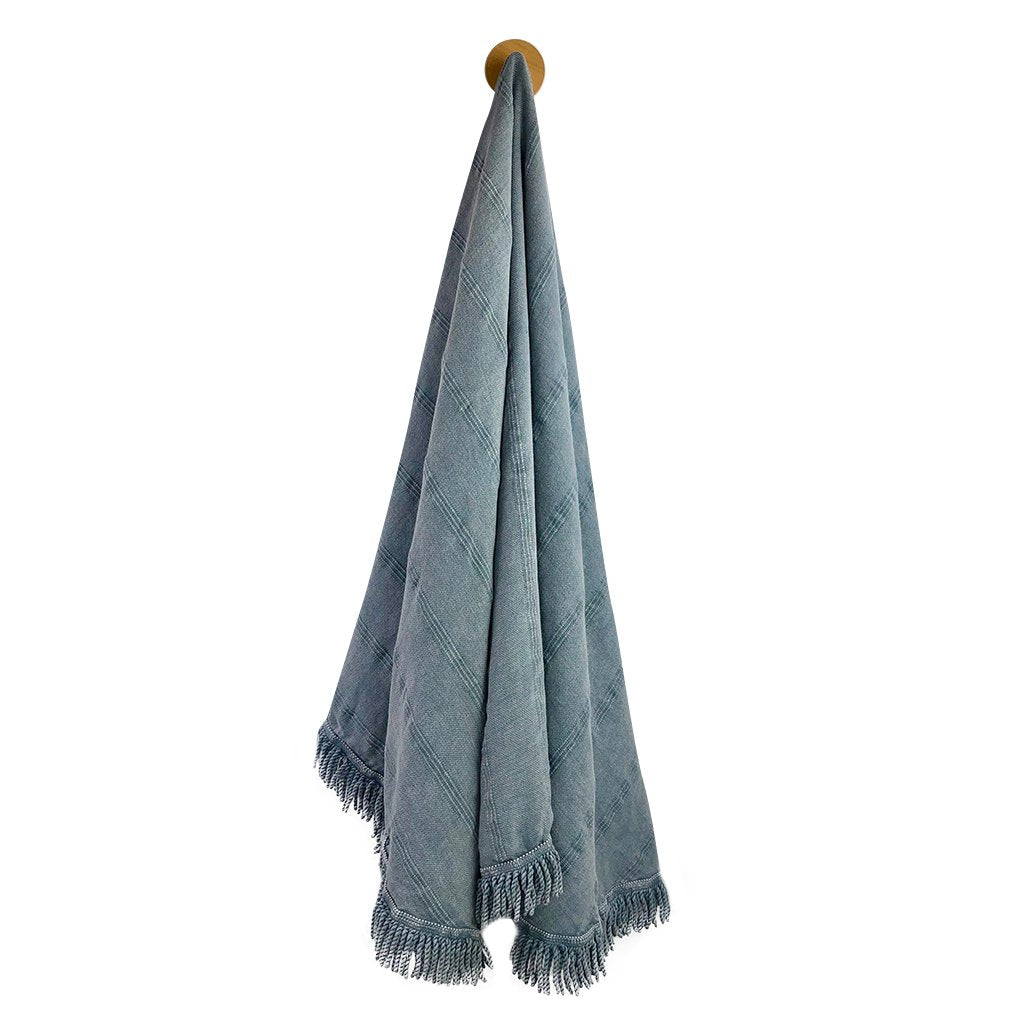 Stonewash Turkish roundie towel in denim perfect for beach or picnic hanging on hook