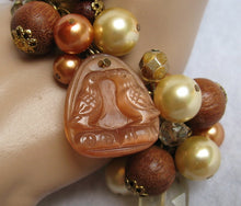 GLASS, PEARL & WOOD BEAD BRACELET WITH RAVEN FOB