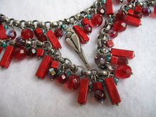 EXOTIC RED & SILVER BEADED NECKLACE W/ CRESTED BIRD DROP