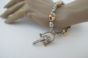 SILVER AND GOLD PARROT STRETCH BRACELET