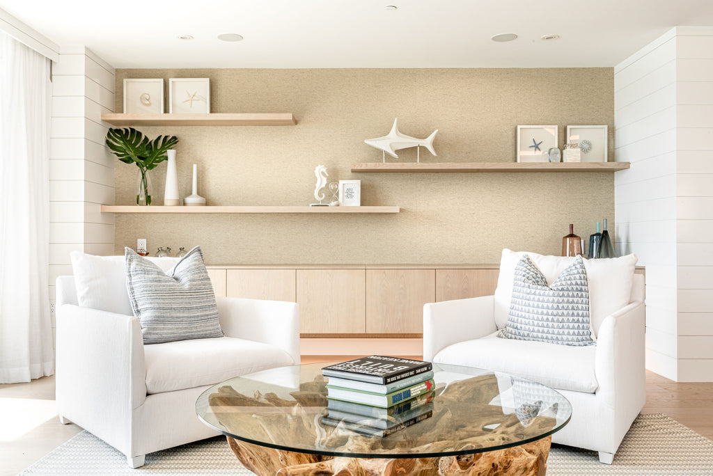 This stunning lounge from a recent Ritz renovation pulls together some of our favorite elements! White oak millwork makes the perfect backdrop for our white linen lounge chairs and the stunning organic root coffee table. Coastal perfection!