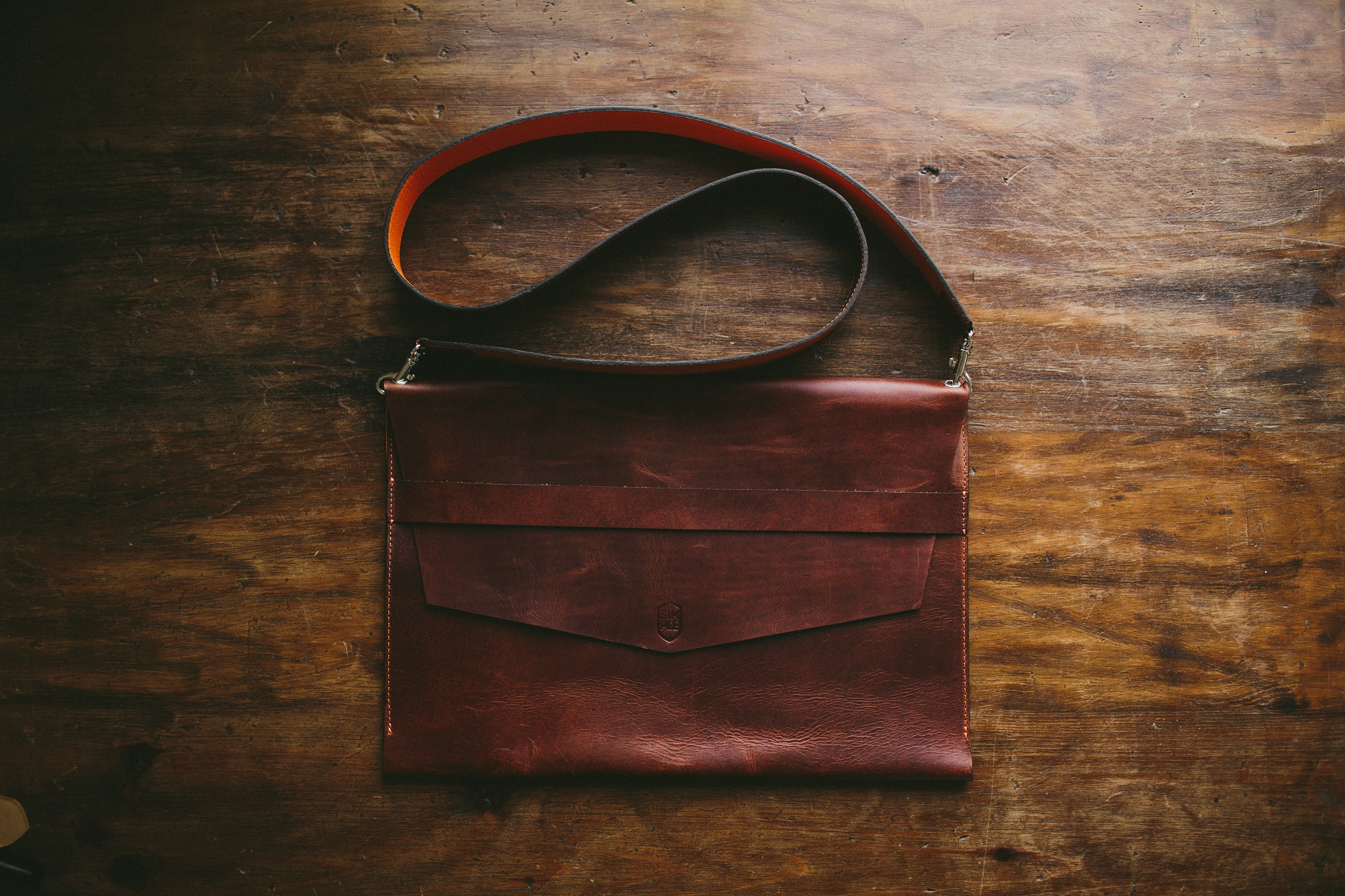 brown leather laptop sleeve, with shoulder strap, front side