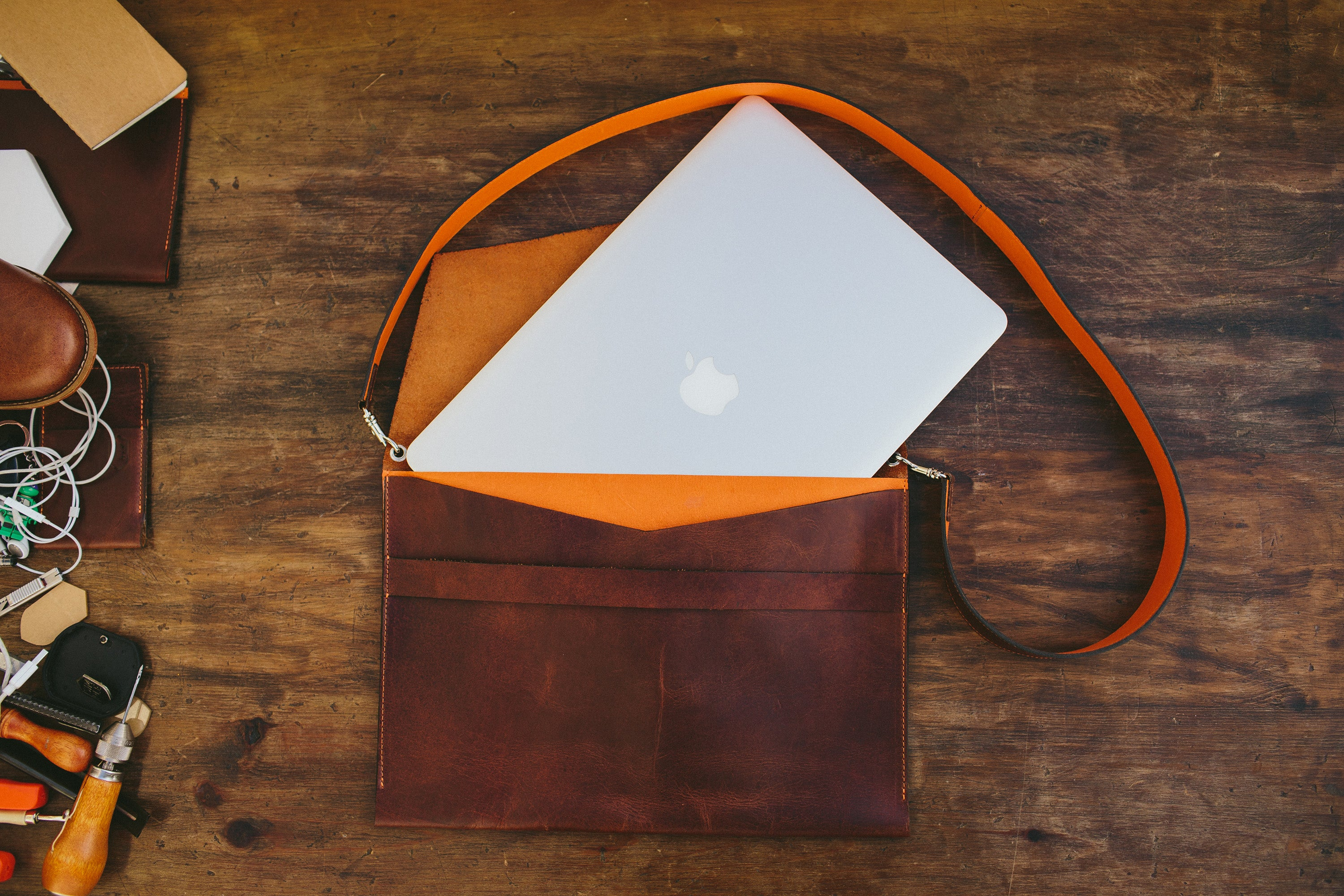 brown leather macbook sleeve, with shoulder strap, front side