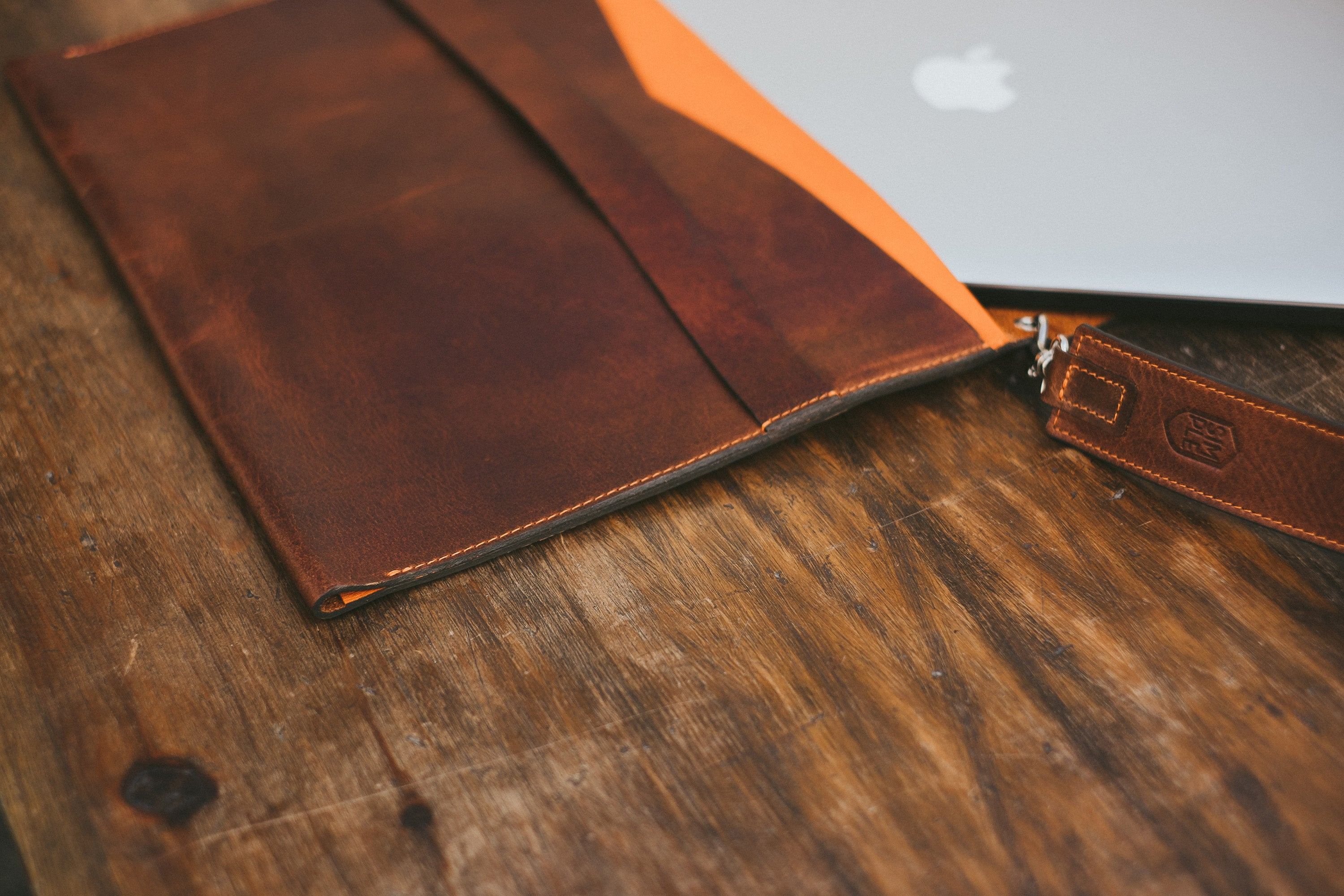 brown leather macbook pro sleeve, with shoulder strap, front side