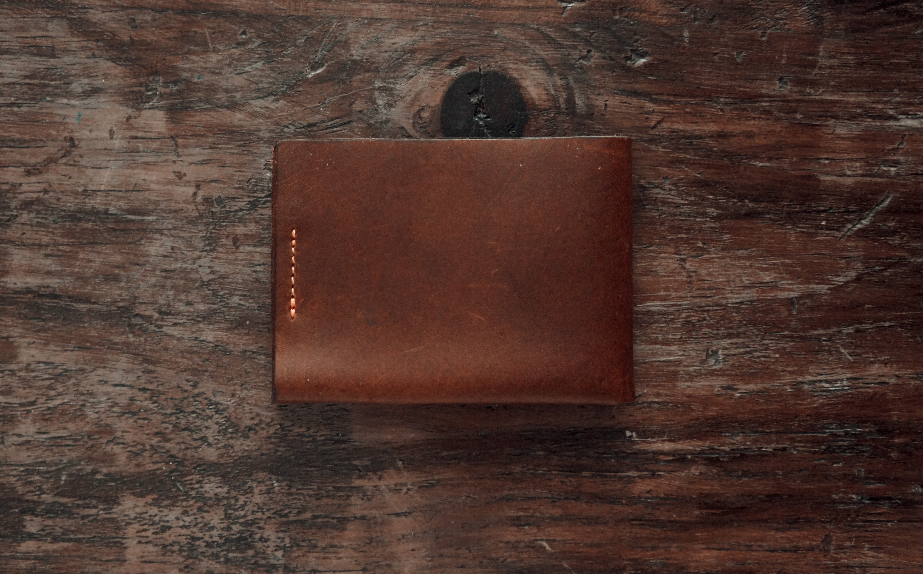 handmade brown leather bifold slim wallet, back side