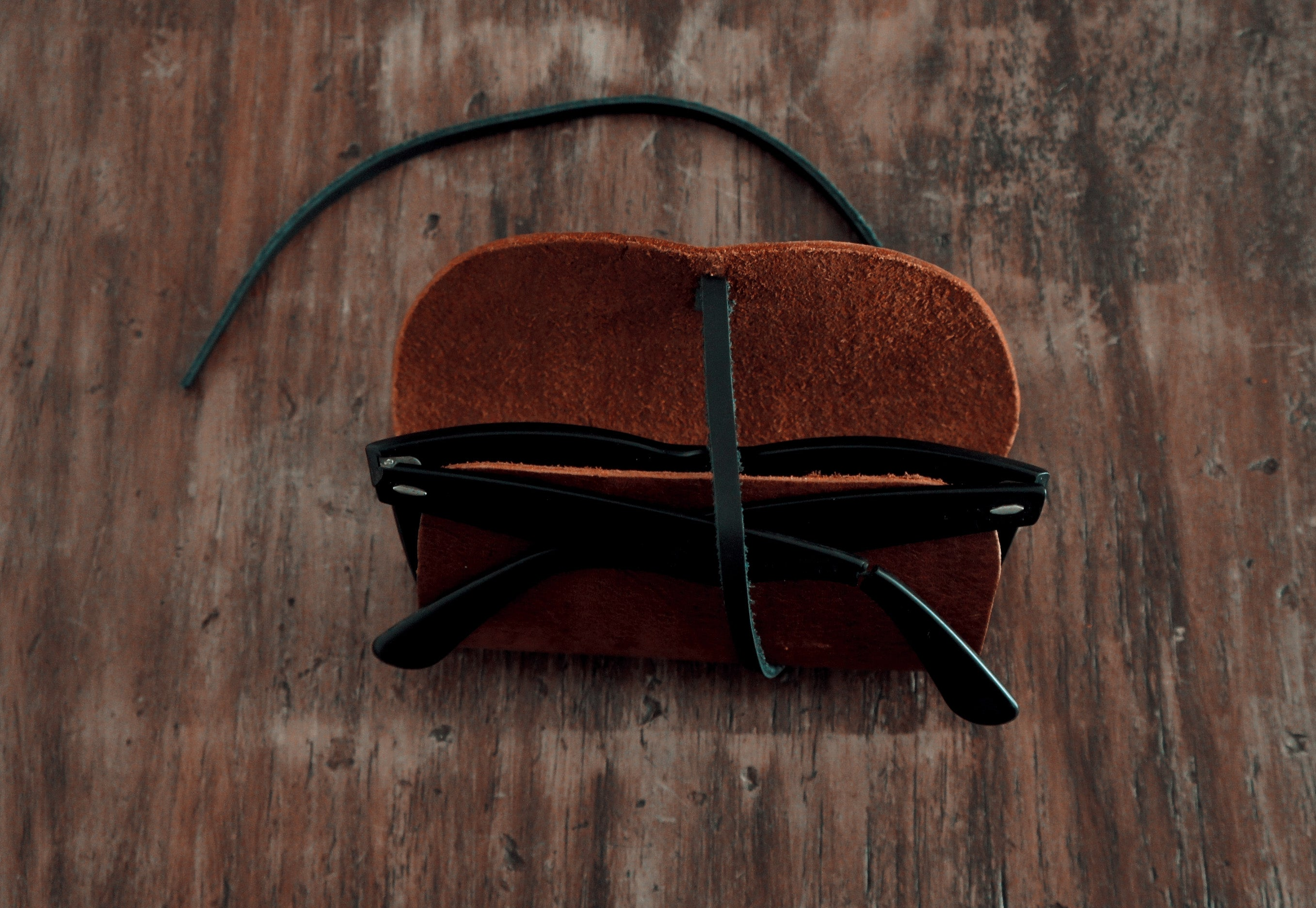Brown leather sunglass case wrap with black strap- Leather Goods