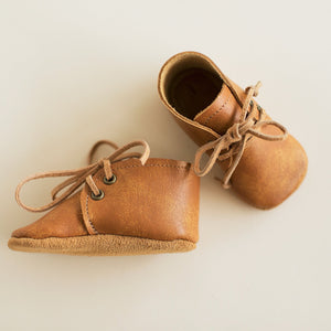 orange baby desert boots with soft soles