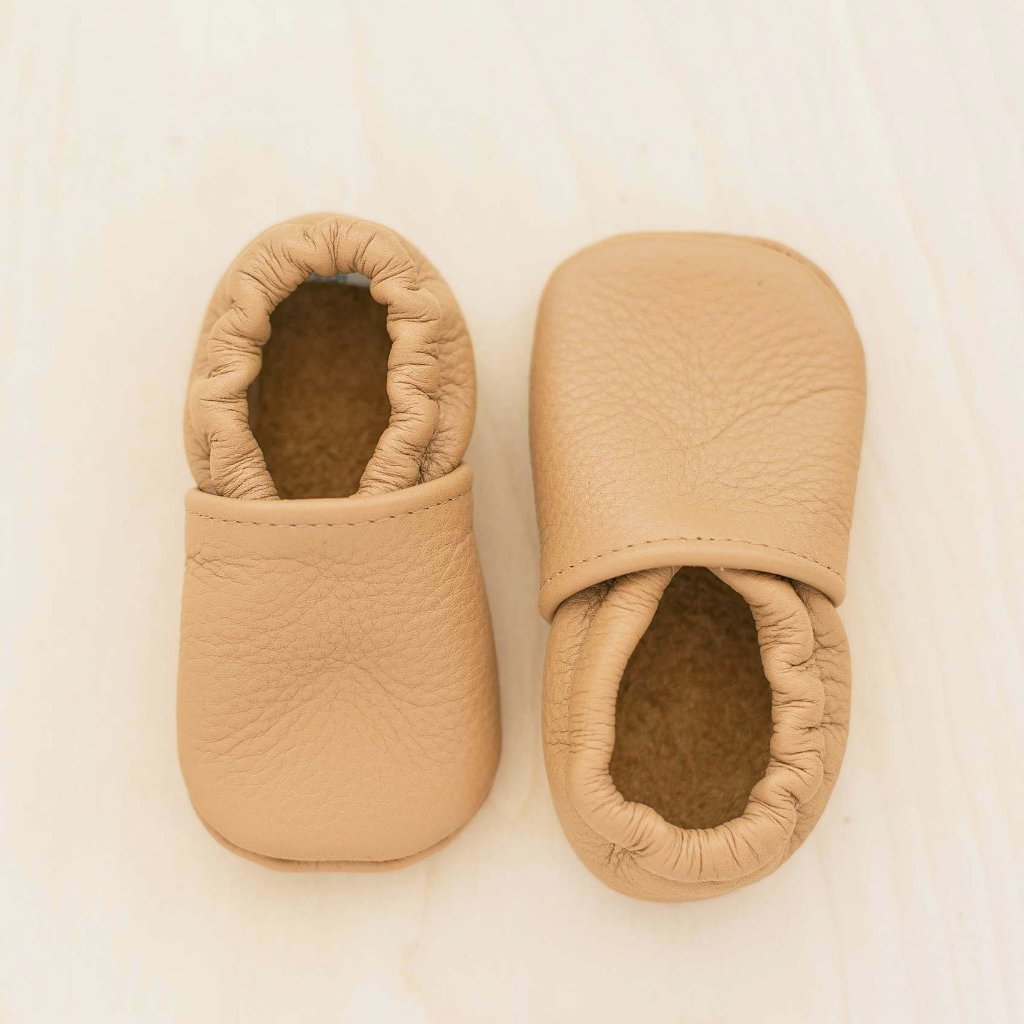 butterscotch leather gender neutral baby moccs. light brown moccs