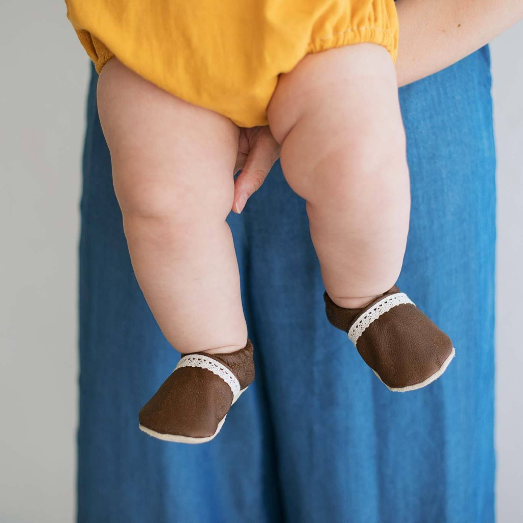 distressed brown leather baby moccs for baby girl